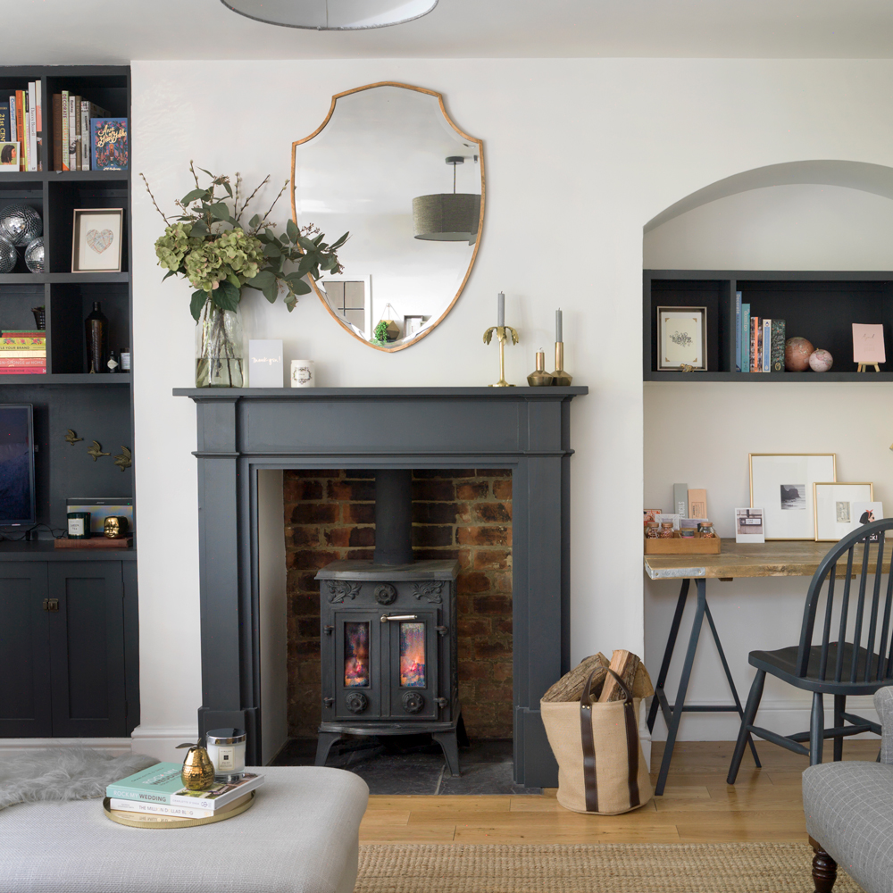 grey living room with black painted alcove and black fireplace