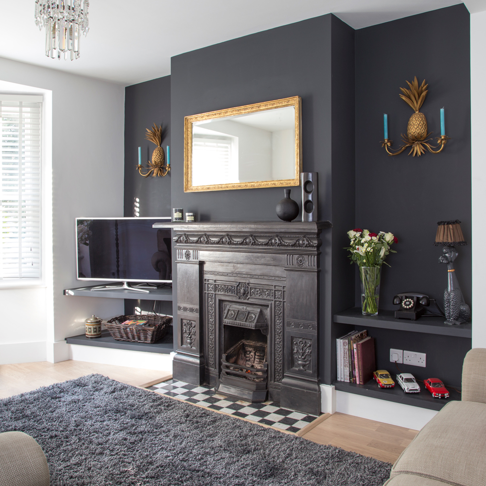 black living room wall with black iron fireplace